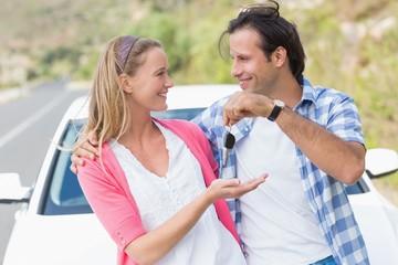 Couple holding key