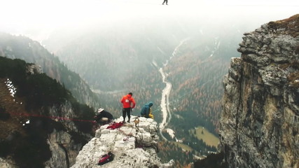 Aerial shot of man walking in the air in mountain with snow