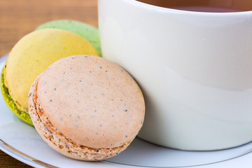 Closeup Macaron and Teacup on wood