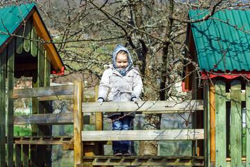 Cute little girl portrait , spring day, playground