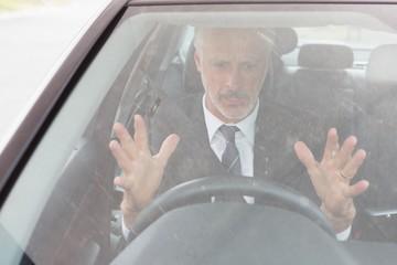 Nervous man sitting at the wheel