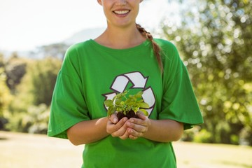 Environmental activist showing a plant