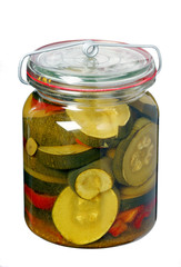 Glass jar with pickled zucchini