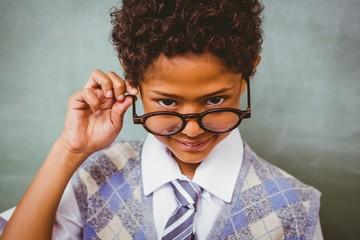 Cute little boy holding glasses