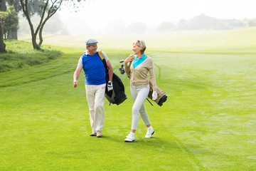 Golfing couple walking on the putting green