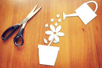 Concept of gardening. Paper flower in a pot