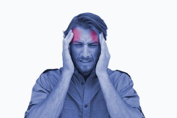 Man wincing with pain of headache