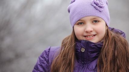 girl laughing in winter CU