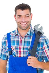 Portrait of confident male repairman holding adjustable wrench