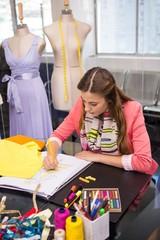 Fashion designer sketching dress