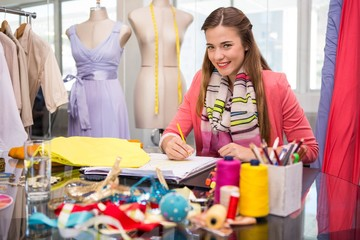 Attractive female fashion designer sketching