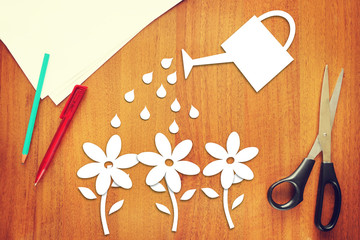 Concept of gardening. Watering of flowers made as scrapbooking
