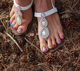 Trendy Pedicure Outdoors with Pine Cones, Closeup