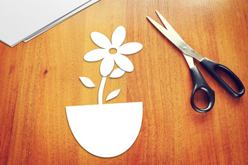 Paper flower on the wooden table