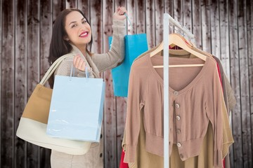 Composite image of smiling woman shopping