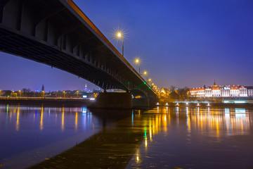 Vistula river scenery with bridge and Royal Castle in Warsaw