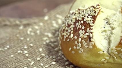 Fresh baked Pretzel Sesame Roll (not loopable 4K UHD footage)
