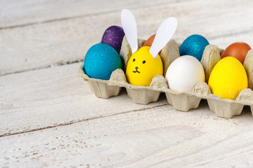 Colored easter eggs with egg-shaped bunny