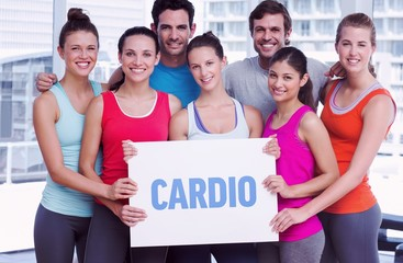 Cardio against fit smiling people holding blank board