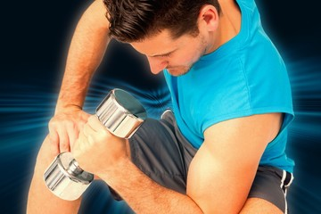 Fit man exercising with dumbbell