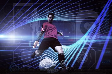 Composite image of goalkeeper kicking ball