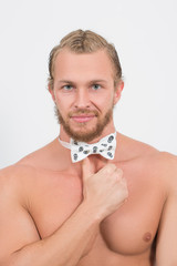 topless man wearing a skull, neckbow and smiling