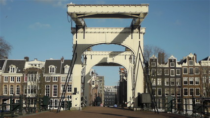 Historic canal houses and elegant bridge in Amsterdam