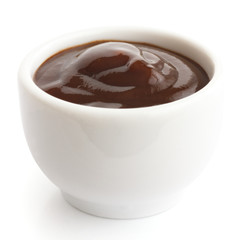 English brown sauce in small white dish.
