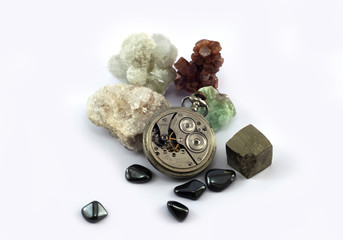 Old pocket watch and gemstones