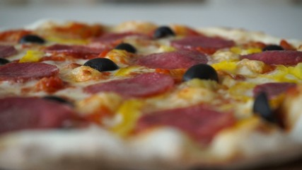Italian pizza cheese olives pepper