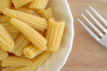 Close view of baby corn nuggets in bowl