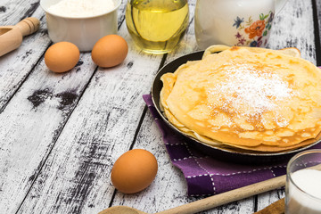 stack of pancakes and ingredients