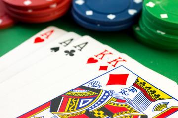 Poker chips & full house cards