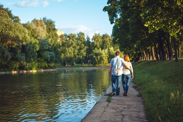 Couple walk alongside river