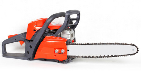 New red gasoline chainsaw isolated on white background