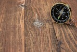 Gold Compass On Wood Background