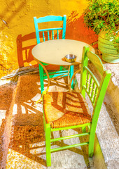 two chairs and a coffee table in Plaka, Athens Greece. HDR