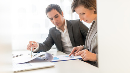 Business People Reviewing Business Reports