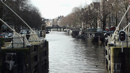 Sluice and canal. Haarlemmersluis in Amsterdam, the Netherlands
