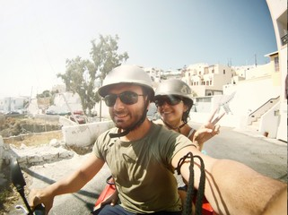 Young couple while taking a Selfie on quad.