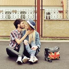 Kissing couple outdoor portrait