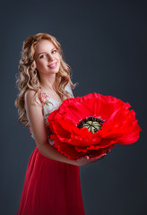 The smiling blonde girl with huge poppy-flower in her hands.