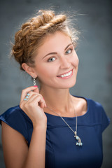Fair-haired lovely girl with beautiful braided hair. Close portr