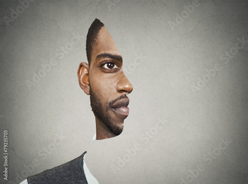 Optical illusion portrait front with cut out profile of man - 79235703