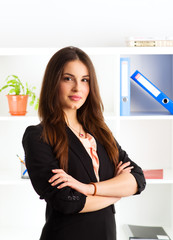 Portrait of confident female CEO standing in her office.