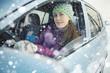 female driver in the car in winter - 79237192