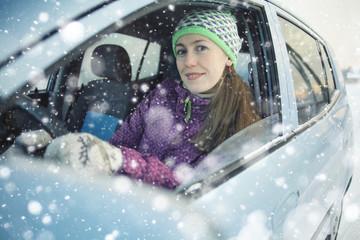 female driver in the car in winter