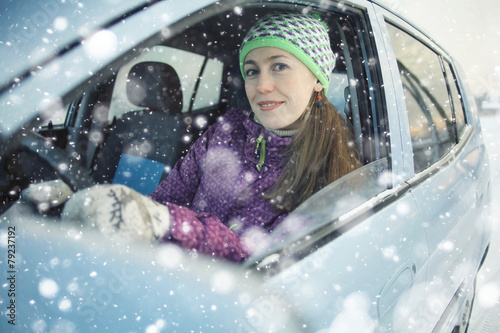 female driver in the car in winter - 79237192