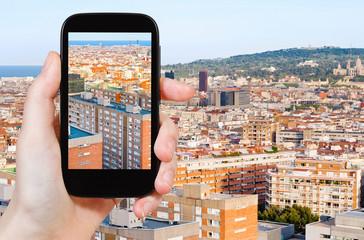 tourist taking photo of Barcelona skyline