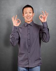 Asian Man Shows OK